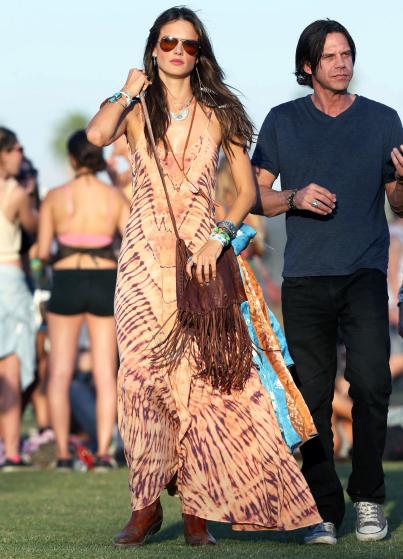 Alessandra Ambrosio dances in the field at Coachella festival.